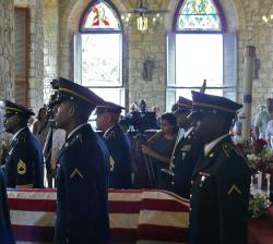 V.I. National Guard pallbearers carry Gov. Juan F. Luis' casket out of Christiansted's Holy Cross Catholic Church at the conclusion of his funeral Thursday.