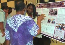 Jamila Martin explains her project on the Salt River bioluminescent mangrove at Saturday's UVI Research Symposium.