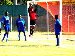 UVI goalkeeper Troy Miessau goes high to collect a corner kick.