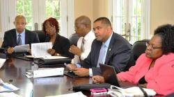 Gov. John deJongh Jr. and his financial team meeting with bond rating agencies (Government House photo).
