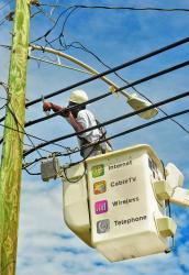 Innovative employee Russell Gumbs working on the St. Croix network (photo courtesy of Innovative).