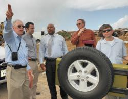 WAPA Executive Director Hugo Hodge Jr. inspects the Bovoni landfill as a possible site for the wind speed study.