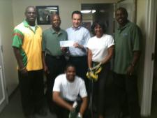 Hamish Anthony, team coach; Kenneth Allen, team founder and president; Gonzalez; Sharon Flamon, executive secretary to Gonzalez; Juneny Anthony, team captain; and Mardochee Pierre, team fan.