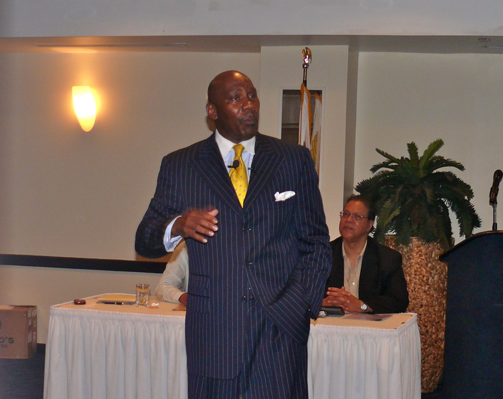 Motivational speaker Columbus Copeland looked to inspire laid-off workers during Monday's event at Divi Carina Bay Resort.