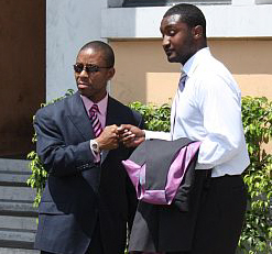 Amos Carty Jr. (left) shakes hands with Jay Crawford after the mistrial was announced.