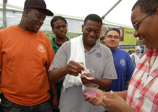 Students from the National Society for Black Engineers demonstrate nano technology.