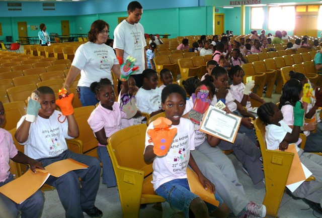 Students from Alfredo Andrews After School Program show off their hand-made puppets Thursday after putting on a series of puppet shows on kindness to animals.