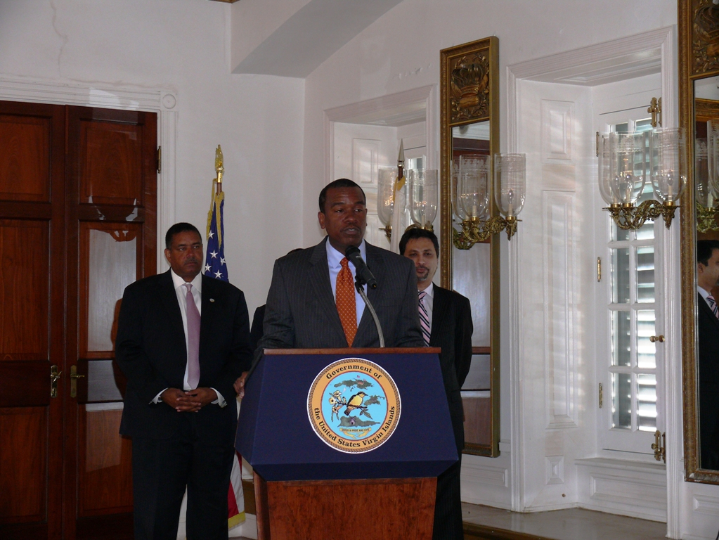 Labor Commissioner Albert Bryan at the Youthnet unveiling, flanked by Gov. John deJongh Jr. (left) and BizVI President Syed Gilani.