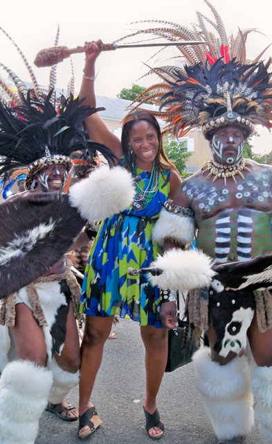 Delegate-elect Stacy Plaskett poses with the Zulu troupe Saturday in the Crucian Christmas Carnival Adult Parade.