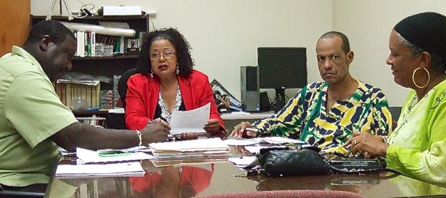 From left, Board of Elections members Raymond Williams, Lilliana Belardo de O'Neal, Glenn Webster and Lisa Harris-Moorhead meet Wednesday.