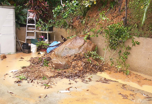 Rain sent this boulder crashing down the hill on St. Thomas's northside. (W. Bostwick photo)