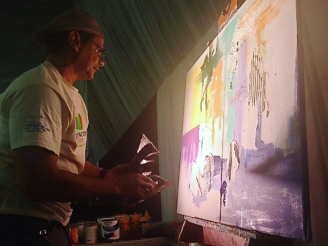 Artist Ensor Colon works on a piece during the gala that was auctioned during the event.