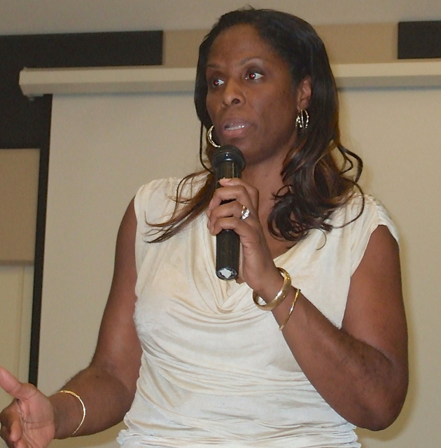 Delegate Stacey Plaskett takes a question Wednesday during her UVI townhall meeting.