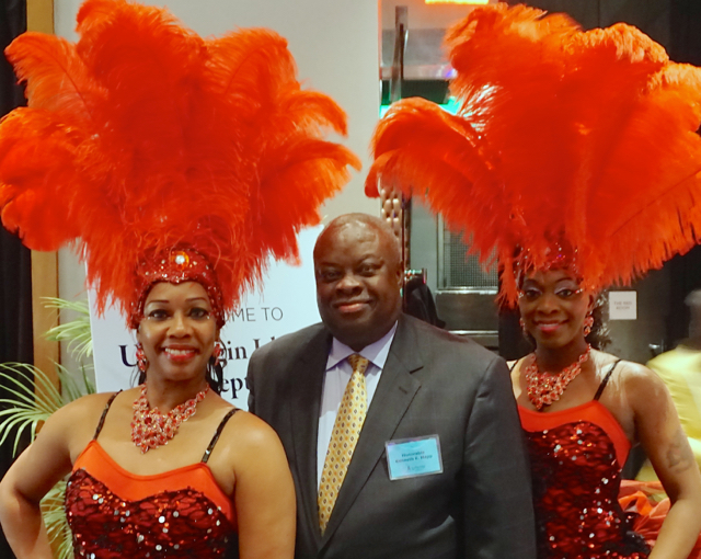 Gov. Kenneth Mapp with two dancers from the USVI.