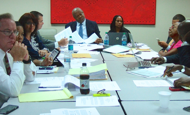 JFL board members and staff listen to reports at Saturday's meeting.