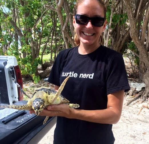 Vet tech Erica Palmer holds a turtle she cares for at marine park. (Photo provided by Coral World.)