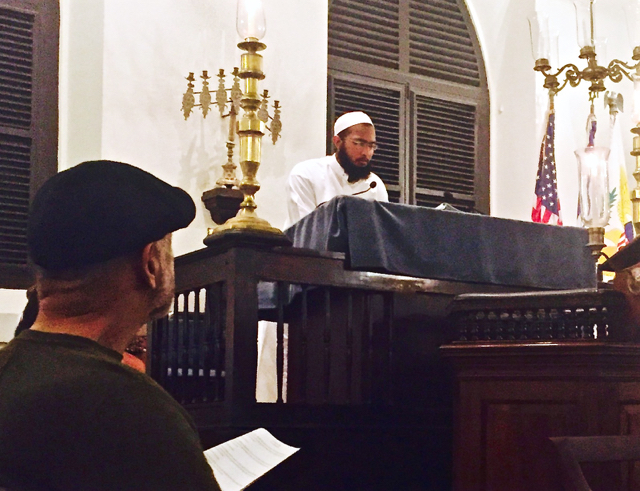 Imam Abubakar Mohammed of the Nur Islamic Center of St. Thomas addresses the 'Shabbat of Solidarity' on Friday evening.