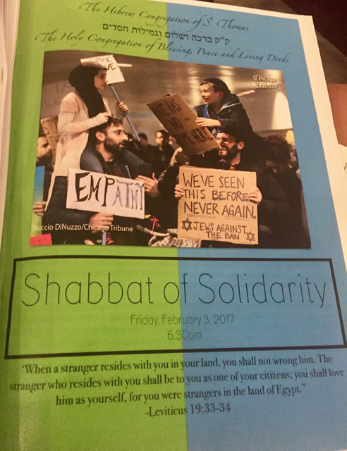 The program for the 'Shabbat of Solidarity' featured a well-circulated photo published in major newspapers in the week after the immigration ban was announced..