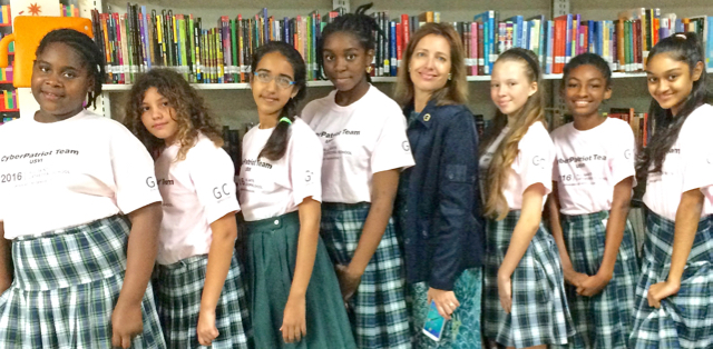 The V.I. Kings Cyber Patriot team, from left, Kaylin Wallen, grade 7, age 12; Mimi Boumedine, grade 6, age 11; Drishti Tejwani, grade 7, age 12; J'Synyah Hyndman, grade 8, age 13; Rebecca Hoffart, coach; Angela Blake, grade 8, age 13; Iyana Frett, grade 6, age 11; Sakhshi Parwani, grade 7, age 12.