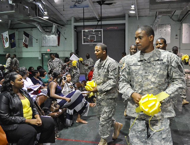 Sgt. Janeel Gumbs and Staff Sgt. Wilfred Todman hand out yellow ribbons to loved ones before deployment.