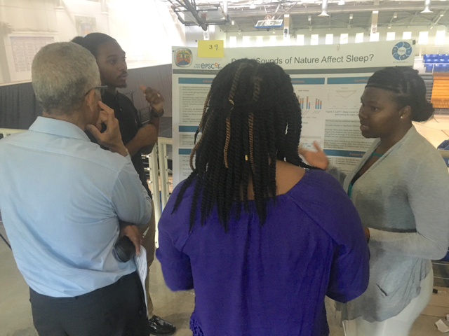 Travis Jarvis and Shanice James presenting their research project, 'Do Sounds of Nature Affect Sleep?' at the UVI Summer Research Symposium.