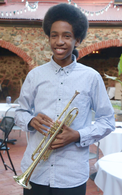 Keyshawn Hardy, the leader and youngest member of the Virgin Island Youth Ensemble, posing with the Jerry Silverberg Trumpet Award he recently received. (Photo provided by Branford Parker)