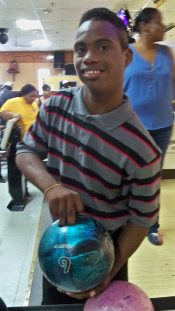 Jaydin Velazquez selects a bowling ball for the Back to School Unified Bowl-a-Rama.