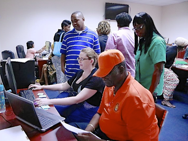 Elections' workers and board members start counting ballots Saturday in the St. Thomas Elections office. (James Gardner photo)