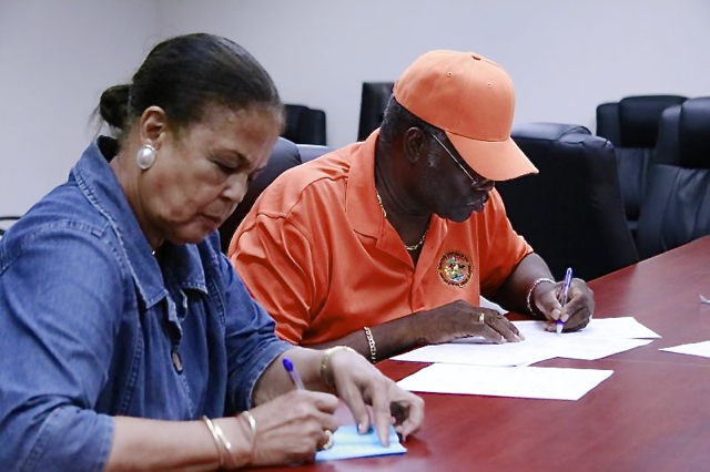 St. Thomas-St. John Board of Elections member Harry Daniel reads the unofficial results while member Wilma Marsh-Monsanto records the tally. (James Gardner photo)