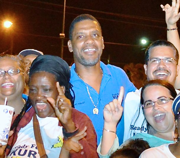 Kurt Vialet celebrates with supporters Saturday night outside of the Elections Office in Sunny Isles. (Bill Kossler photo)