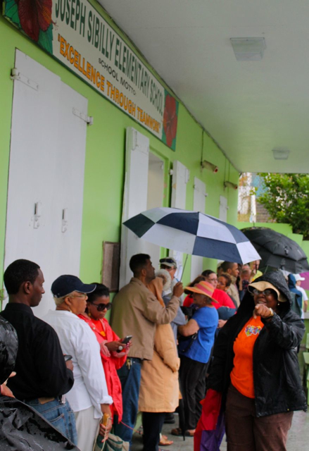 Voters look for the start of the line at Sibilly School. The primary election took place despite the interference of Tropical Storm Bertha.