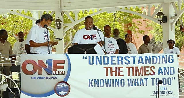 Members of One Voice Virgin Islands speak at Thursday morning's rally in Emancipation Garden.