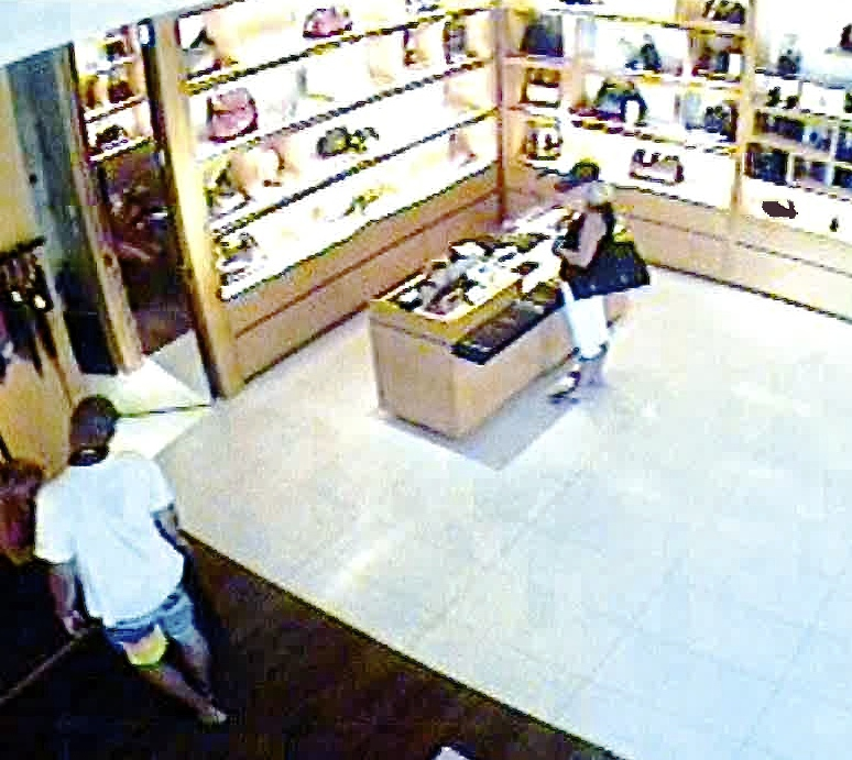 Security camera snaps a picture of an unidentified woman authorities say is using a stolen credit card. Police want the community's help in identifying the suspect.