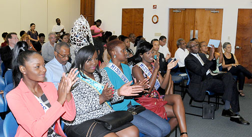Miss UVI 2014 contestants and reigning Miss UVI Murchtricia Charles, second from left, applaud keynote speaker Palmer. (Photo provided by UVI)