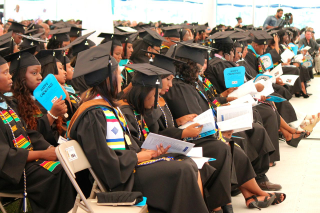 UVI graduates listen to speakers at commencement ceremonies on St. Croix Sunday.