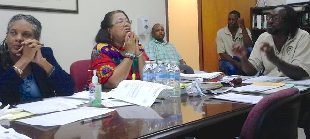 Lisa Harris-Moorhead and Liliana Belardo de O'Neal listen to Chairman Adelbert Bryan at the St. Croix Elections Board meeting Wednesday.
