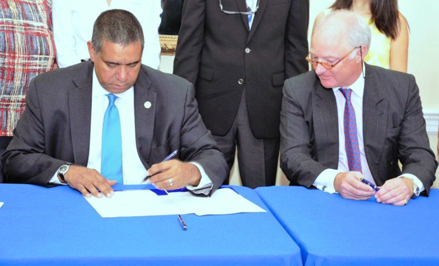 Gov. John deJongh Jr. and Stephen Evans-Freke, managing partner of Water Island Development Company, sign a lease agreement Wednesday morning that will facilitate the development of a boutique resort on Water Island. (Government House photo)
