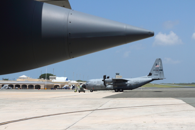 Four WC-130J aircraft sit on the tarmac at the Henry E. Rohlsen Airport on St. Croix, where the Hurricane Hunters have their forward operating base.
