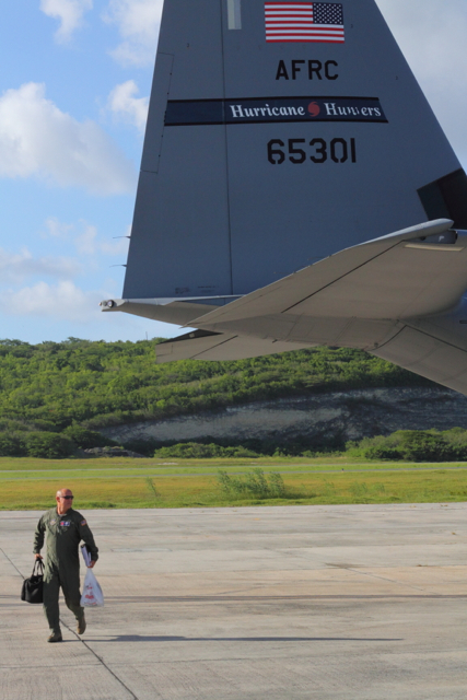 Lt. Col. Kevin McLuen walks behind his plane after a successful mission.