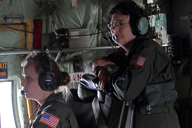 Lt. Col. Valerie Hendry watches over the shoulder of her apprentice, 2nd Lt. Leesa Froelich at the weather station.