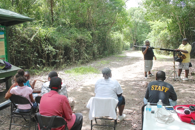 The young film team comes up with a game plan for filming a scene at the Alphonso Nelthropp Arboretum. (Jae Knight photo)