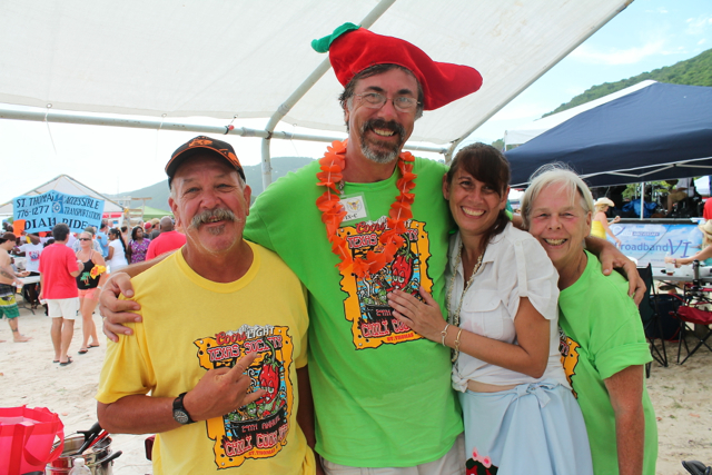 From left, CASI category champion Ron Baker, Chili Cook-off organizer Erik Ackerson and a pair of cook-off volunteers.