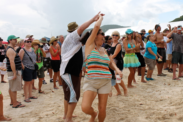 A couple dance in the sand to the live music at the chili cook-off.