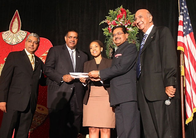 From left, India Association Vice President Pash Daswani, Gov. John deJongh, UVI official Dionne Jackson, India Consul General Ajit Kumar, and association President Mulo Alwani with a scholarship donation.