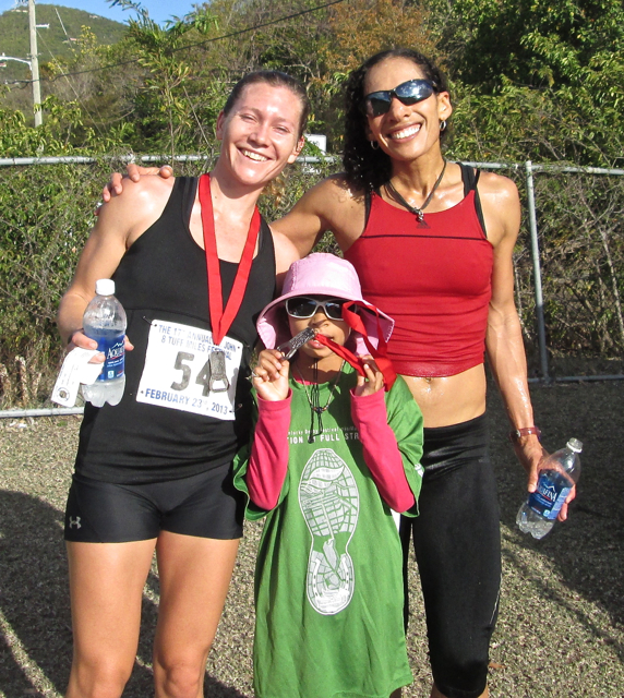 Women's winner Ruth Ann David, right, her daughter Shaiah David, and second place women's finisher Devon Nemire-Pepe celebrate at the end of a tough race..