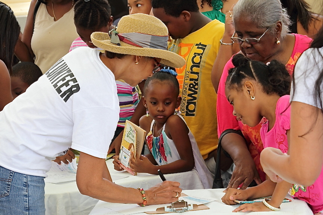 Kids sign up for the Governor's Summer Reading Challenge Saturday at Sunny Isle.