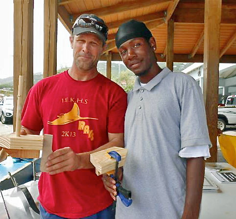 IEK marine instructor Stanley Lorbach, left, and student Kolanni Edwards, helped assemble wooden boats.