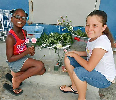 Briana Burgin, left, and Christa Greaux make floral arrangements.