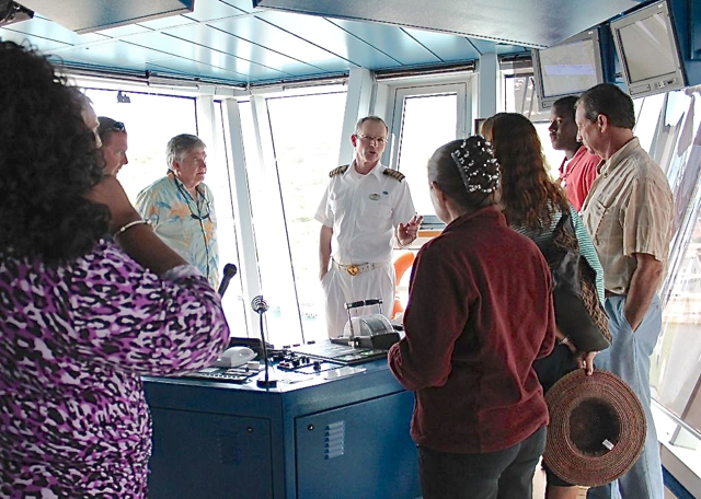 Emerald Princess captain Nicholas Nash, center, treat the awardees to a rare tour of the bridge.