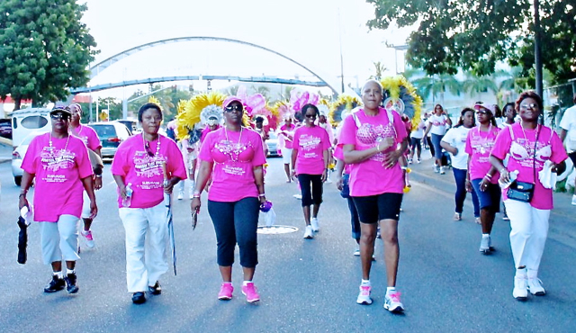 Cancer survivors lead the march down Veterans Drive Sunday.